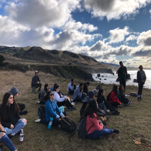 EAHS biology class outdoors on the coast